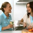 Stock Video: Friends laughing together while one is preparing dinner