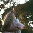 Beautiful young woman leaning in her husband's arms — Stock Video #27025059
