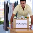 Stock Video: Volunteer holding donation box