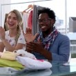 Stock Video: Fashion designers applauding together