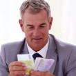 Stock Video: Happy businessmcounting banknotes