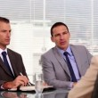 Businessmen talking to an applicant — Stock Video