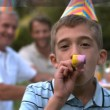 Little boy blowing party horn — Stock Video