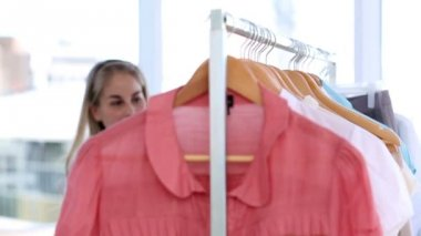 Woman doing shopping in clothes shop — Stock Video
