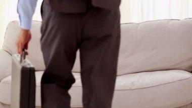 Smiling businessman lying on sofa — Stock Video