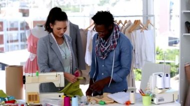 Fashion designers working together with a fabric — Stock Video