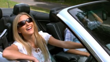 Woman smiling at camera in her car — Stock Video