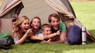 Young family lying in their tent — Vidéo