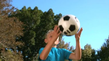 Little boy heading a football — Stock Video