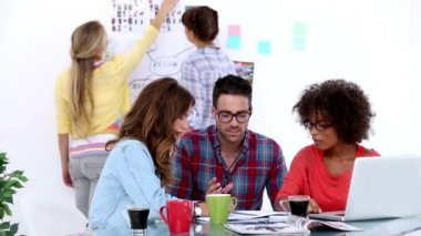 Team of designers brainstorming in their office — Stock Video