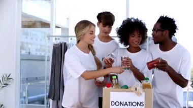 Volunteers watching the food in donation box — Stock Video