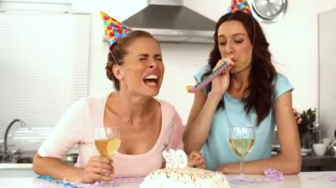 Women wearing party hats celebrating birthday together — Stock Video