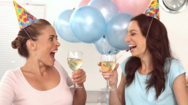 Women clinking their flutes of champagne for a birthday — Stock Video