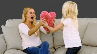 Little blond girl offering a heart to her mother in slow motion — Stock Video