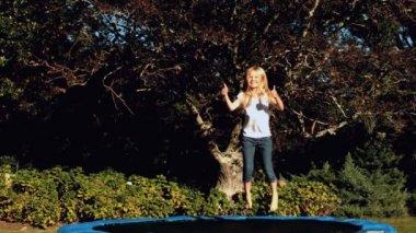 Little girl having bouncing on a trampoline — Stock Video