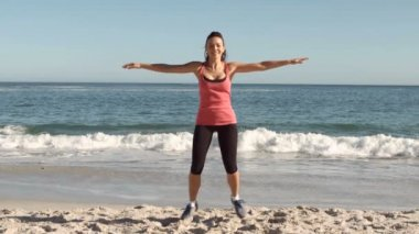 Happy woman working out on the beach — Stock Video