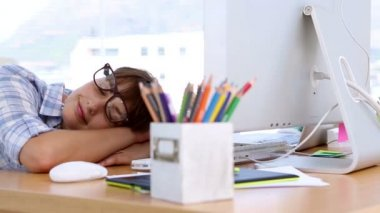 Pretty designer napping on her desk — Stock Video