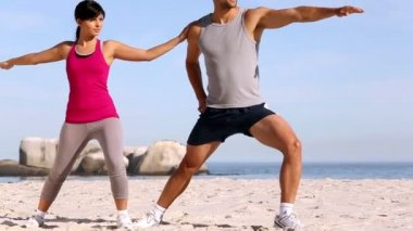 Man and woman training on the beach — Stock Video