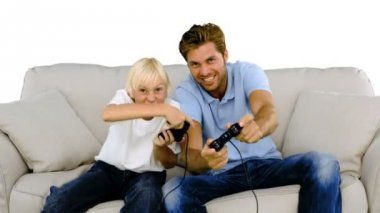 Father and son playing video games on white background — Stock Video