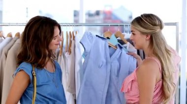 Two cheerful friends doing shopping together — Stock Video