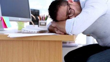 Creative designer napping on his desk — Stock Video