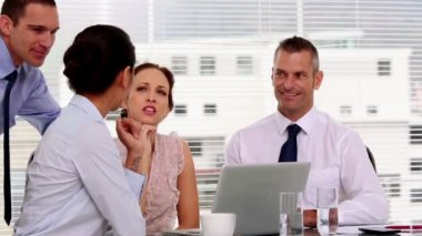 Cheerful business working together in their office — Stock Video