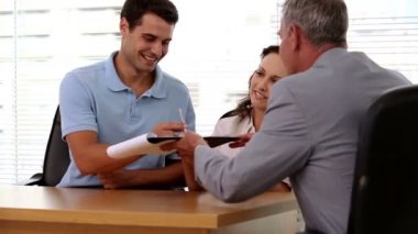 Happy customers signing a contract — Stock Video