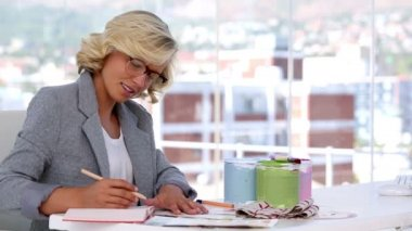 Interior designer taking notes — Stock Video