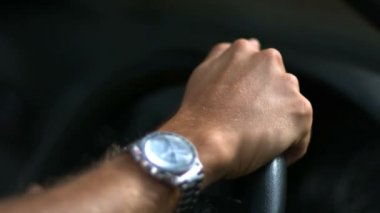 Hands of a man driving a car — Stock Video