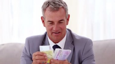 Happy businessman counting banknotes — Stock Video
