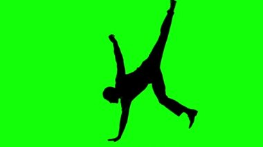 Silhouette of man with a tie breakdancing on green screen — Stock Video