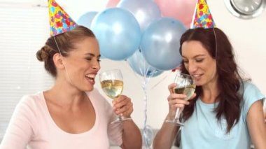 Women clinking their flutes of champagne celebrating a birthday — Stock Video