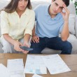 Concerned couple doing their accounts — Stock Photo #28046465