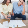 Stock Photo: Concerned couple doing their accounts