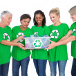 Stock Photo: Team of female environmental activists holding box of recyclable