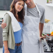 Stock Photo: Couple embracing in kitchen