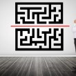 Thoughtful businessman looking at qr code — Stock Photo #28046947