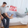 Woman lying on her husband in the couch in their new house — Stock Photo