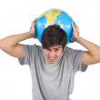 Man suffering while holding a globe — Stock Photo