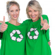 Stock Photo: Two smiling women wearing green recycling tshirts giving thumbs