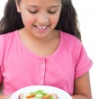 Little girl looking at her sandwich — Stock Photo