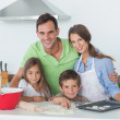 Family baking together in the kitchen — Stock Photo