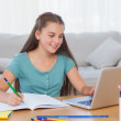 Little girl doing her homework at home — Stock Photo