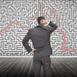 Puzzled businessmlooking at maze — Stock Photo #28047581