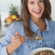 Pretty woman eating cereal — Stock Photo