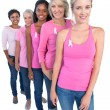 Happy women wearing pink and ribbons for breast cancer — Stock Photo