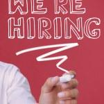 Businessman underlining we're hiring — Stock Photo #28047791