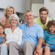 Multi-generation family posing in the living room — Stock Photo #28048079