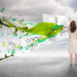 Creative businesswomdrawing on paper next to paint splash — Stok Fotoğraf #28048257