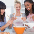 Smiling friends making pastry together — Stock Photo